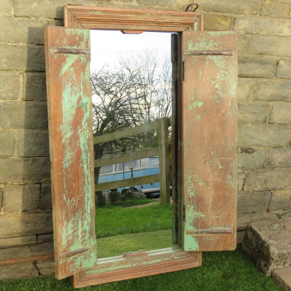 antique hardwood framed mirror with protective shutters in original paint 1860